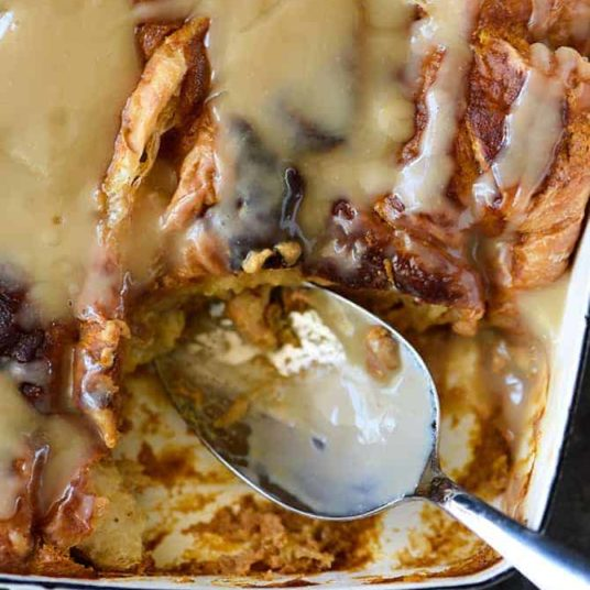 Pumpkin Bread Pudding Recipe with Maple Cream Sauce - Imagine if pumpkin pie and bread pudding came together for the most epic fall recipe! Perfect for the holidays and entertaining! // addapinch.com