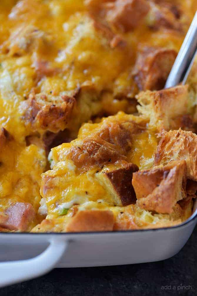 Ham and Cheese Croissant Casserole Recipe - An easy and delicious breakfast casserole that everyone loves! Made of ham, two cheeses, and buttery croissants and baked to perfection! // addapinch.com