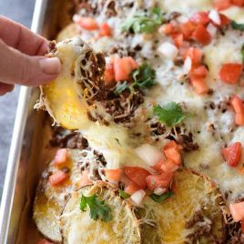 Loaded Potato Skin Nachos Recipe - These nachos will quickly become a favorite with the blend of loaded potato skins and spicy nachos all in one! // addapinch.com