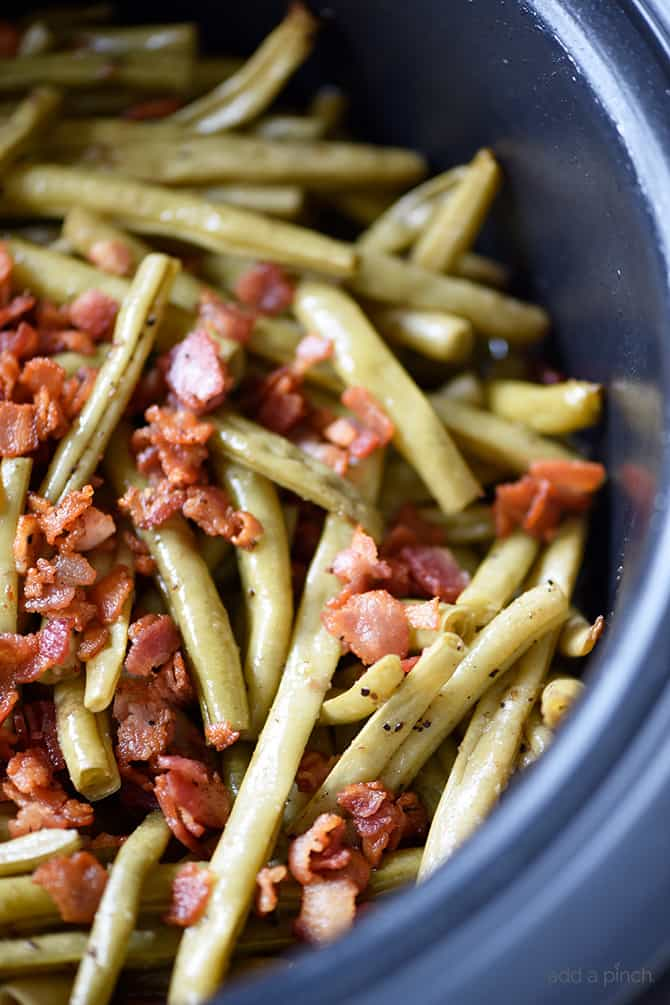 Slow Cooker Green Beans Recipe - These are the best slow cooker green beans and have everyone coming back for more! // addapinch.com