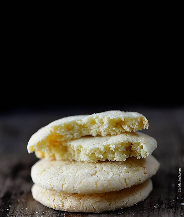 The BEST Chewy Sugar Cookie Recipe - Sugar Cookie Recipe - Absolutely the BEST sugar cookie recipe I've ever tasted! These sugar cookies are soft, chewy and produce a flavorful bakery style soft sugar cookie! Quick and easy to make, this sugar cookie recipe makes cookies that turn out perfectly every single time! // addapinch.com