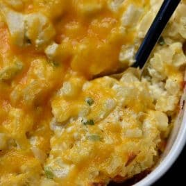 Hashbrown Casserole Recipe - A cheesy potato side dish that comes together in a snap! Perfect to serve when entertaining and a staple on the holiday table! // addapinch.com
