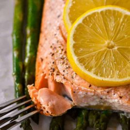 Lemon Garlic Salmon and Asparagus Parchment Packet Recipe - This quick and easy recipe comes together in a snap and is ready and on the table in 15 minutes! // addapinch.com