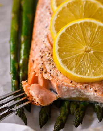Lemon Garlic Salmon and Asparagus Parchment Packet Recipe - This quick and easy recipe comes together in a snap and is ready and on the table in 15 minutes!// addapinch.com