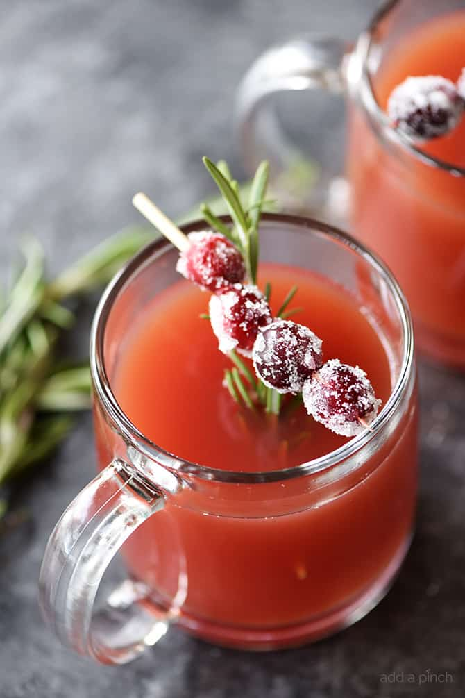 Warm Cranberry Pomegranate Cider Recipe - This quick and easy warm cranberry pomegranate cider recipe makes the perfect sip to stay warm and cozy! // addapinch.com