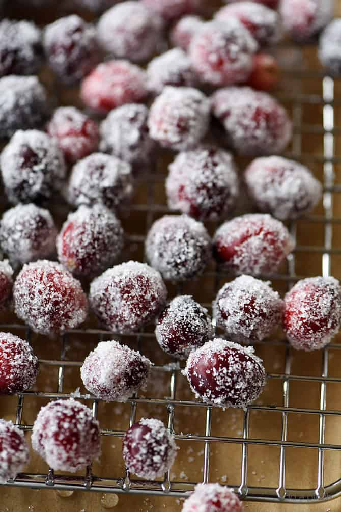 Sugared Cranberries Recipe - These sparkly sugared cranberries come together quickly and easily with just two simple ingredients! Beautiful as garnish for cakes, cookies, cocktails, or to serve as a sweet, yet tart treat! // addapinch.com