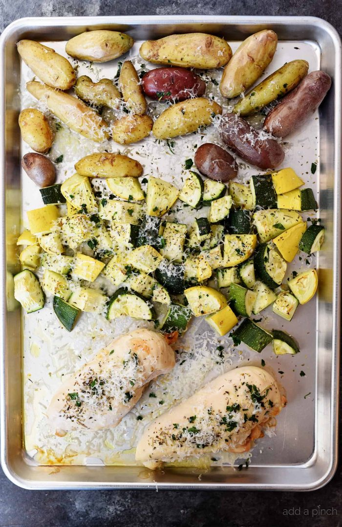 Sheet Pan Parmesan Chicken and Vegetables Recipe - This super easy, 30 minute meal makes a simple, yet scrumptious supper of juicy chicken and vegetables topped with Parmesan! // addapinch.com