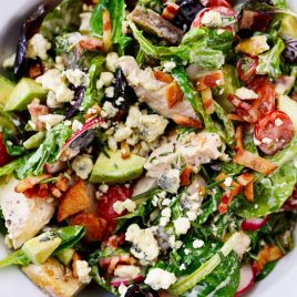 Rosemary Chicken Salad Recipe with Rosemary Ranch Dressing - Tender baked rosemary chicken is the star in this loaded salad recipe topped with a flavorful rosemary ranch dressing. The perfect combination of crunch, creamy, salty and so, so good! // addapinch.com