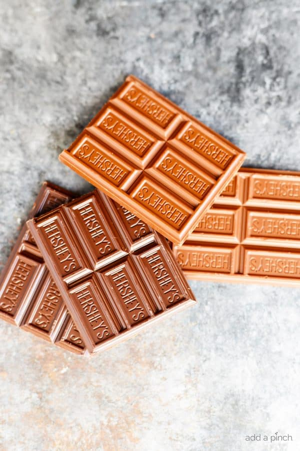 Photograph of milk and dark Hershey's Chocolate Bars on a gray background // addapinch.com