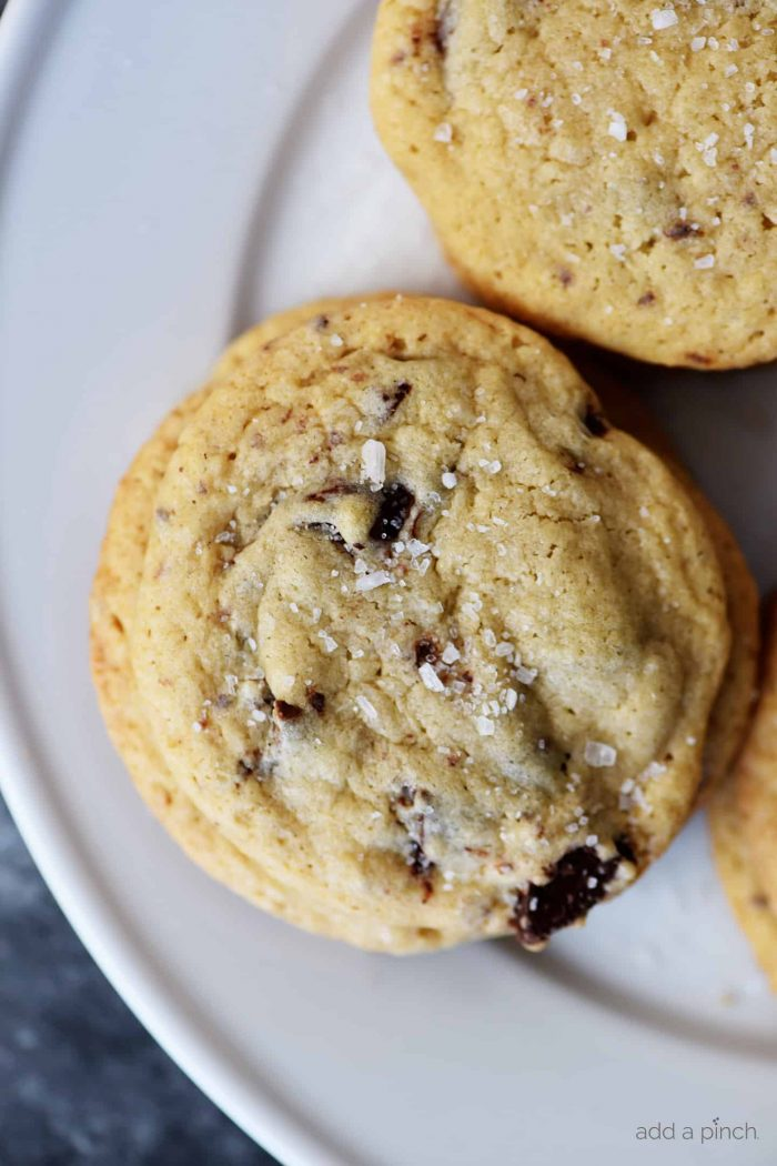 Salted Double Chocolate Chunk Cookies Recipe - An update of the classic chocolate chip cookie with a blend of dark and milk chocolate chunks and a sprinkle of sea salt, these are now a favorite chocolate chip cookie recipe! // addapinch.com