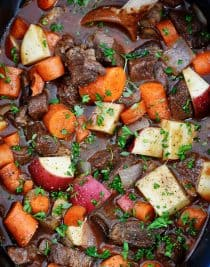 Slow Cooker Beef Bourguignon Recipe -A classicbeef bourguignonrecipe made easy in the slow cooker! Loaded with vegetables, beef, and a thick, rich sauce perfect for entertaining or busy weeknights! // addapinch.com