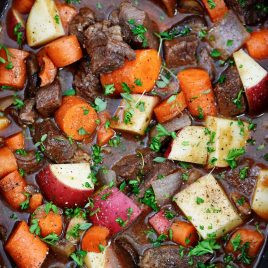 Slow Cooker Beef Bourguignon Recipe - A classic beef bourguignon recipe made easy in the slow cooker! Loaded with vegetables, beef, and a thick, rich sauce perfect for entertaining or busy weeknights! // addapinch.com
