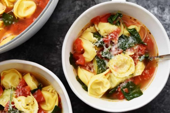 Vegetable Tortellini Soup Recipe - This quick and easy vegetable tortellini soup comes together in minutes for a flavorful soup recipe loaded with vegetables and delicious bites of tortellini.// addapinch.com