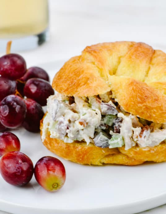 Chicken Salad Sandwich Recipe - A quick and easy chicken salad recipe with grapes made in a delicious sandwich! // addapinch.com