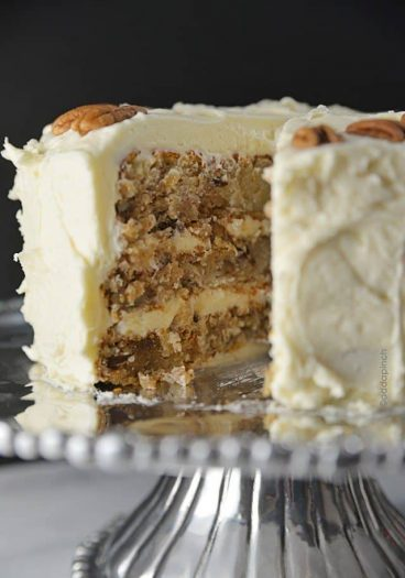 Hummingbird Cake Recipe - Hummingbird Cake is a classic, Southern cake recipe. Made with bananas, pineapple, and pecans and topped with a cream cheese frosting! from addapinch.com