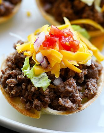 Taco Cups Recipe - This Taco Cups Recipe comes together in 15 minutes for a fast, fun, and fabulous dish! Made with just five ingredients, plus optional toppings, it is sure to be a weeknight staple! // addapinch.com