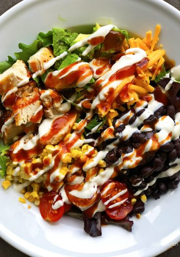 BBQ Ranch Chicken Cobb Salad Recipe - Filled with grilled chicken, corn, black beans, avocado, bacon and more, this flavorful chicken cobb salad recipe is perfect for lunch or supper! // addapinch.com