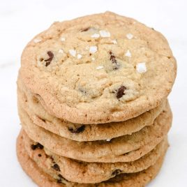 Chewy Chocolate Chip Cookie recipe with a secret little ingredient. They are soft, chewy, and amazing! Learn the secrets to the chocolate chip cookies that everyone requests! // addapinch.com