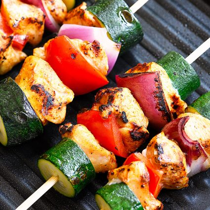 Chili Rubbed Chicken Skewers Recipe - Ready in minutes, these chicken skewers are a weekend AND a weeknight favorite! The secret is the chili rubbed chicken! // addapinch.com