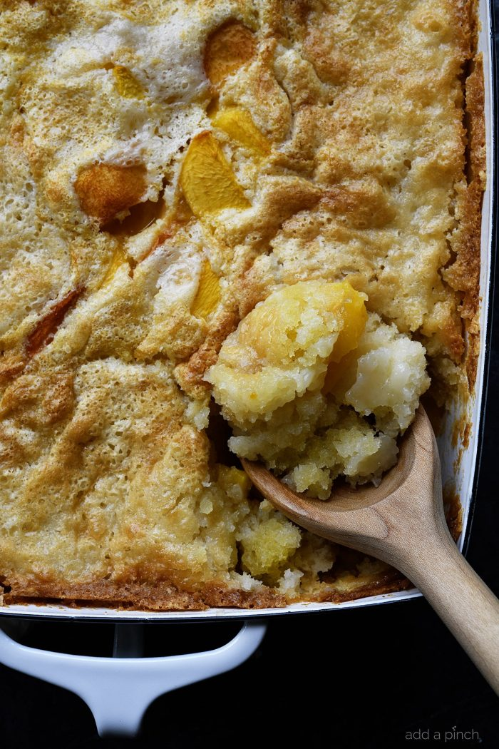 Easy Peach Cobbler Recipe - This easy peach cobbler makes the perfect Southern dessert! A buttery crust tops sweet peaches in this delicious dessert! // addapinch.com