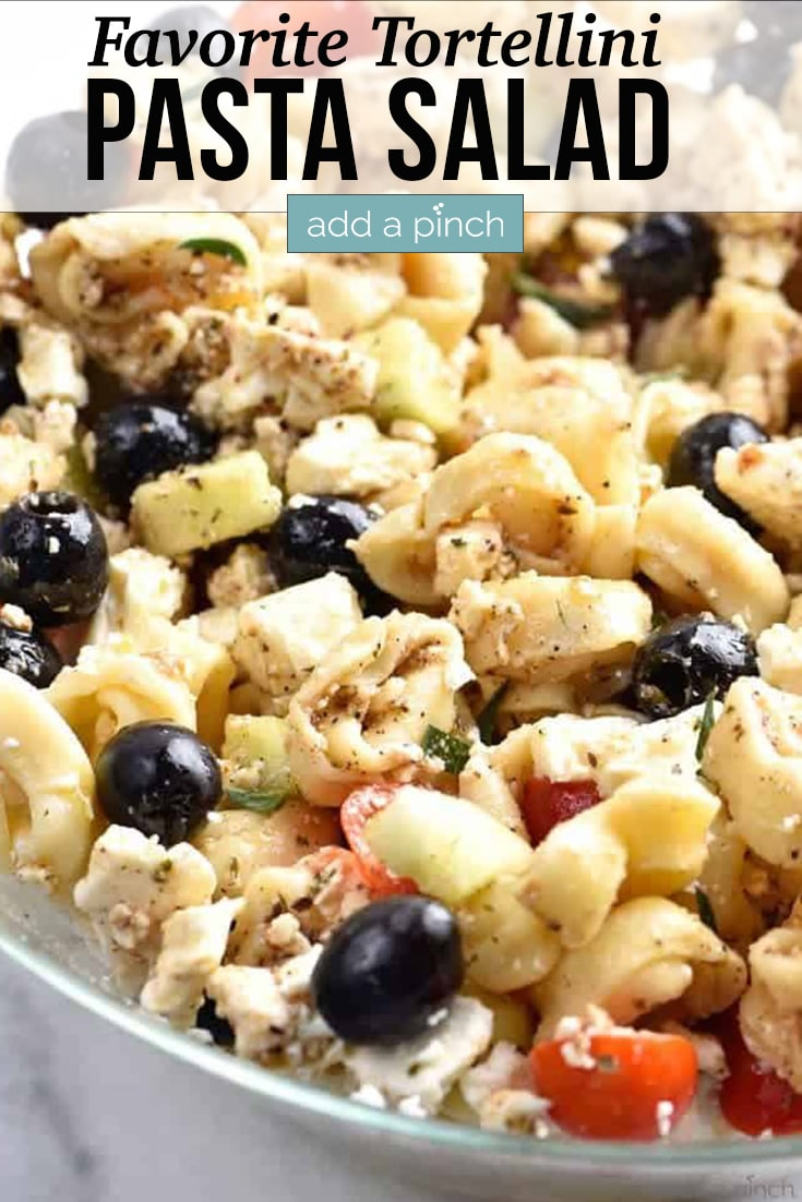 Tortellini Pasta Salad in bowl - with text - addapinch.com
