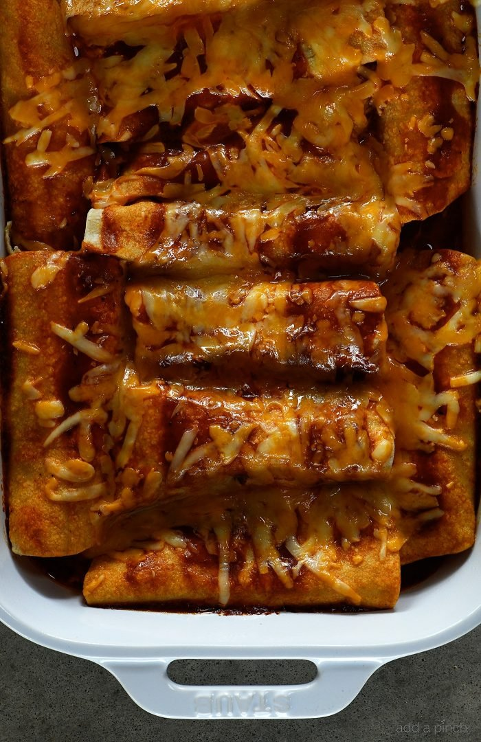 Buffalo Chicken Enchiladas Recipe - These quick and easy buffalo chicken enchiladas are so simple, yet scrumptious! Ready and on the table in 30 minutes! // addapinch.com