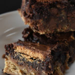 Peanut Butter Cup Brookies Recipe - This recipe takes brownies to a whole new level! Layers of chocolate chip cookie, fudgy brownies, and peanut butter cups make a dessert that everyone loves! // addapinch.com