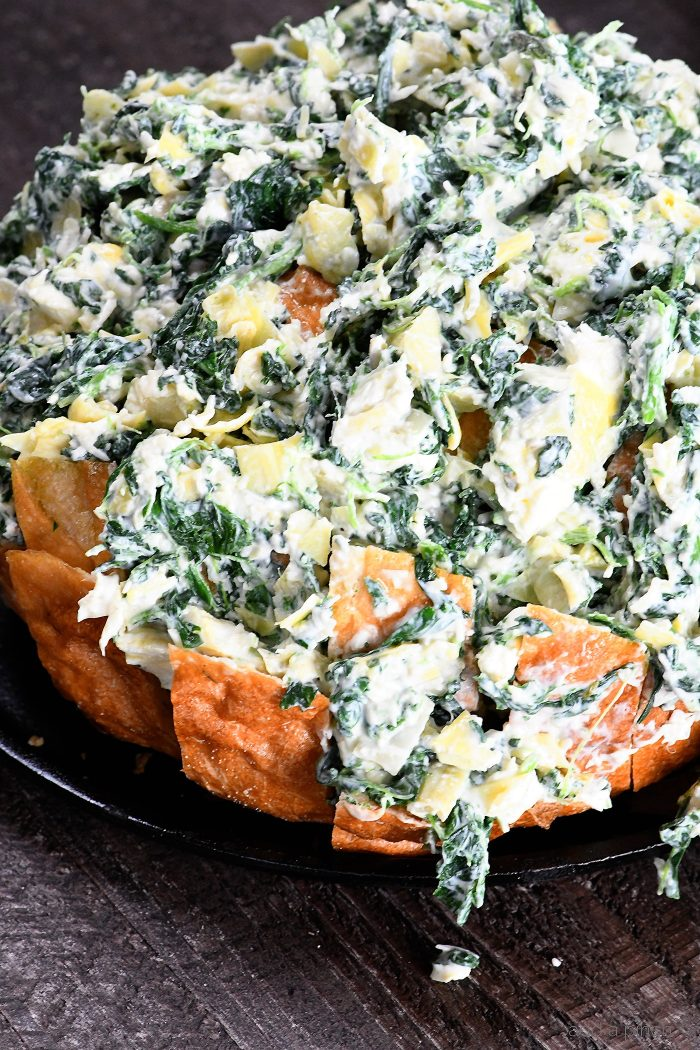 Spinach Artichoke Pull Apart Bread Recipe - Everyone's favorite spinach artichoke served in a whole new way in this fun and easy pull apart bread! // addapinch.com