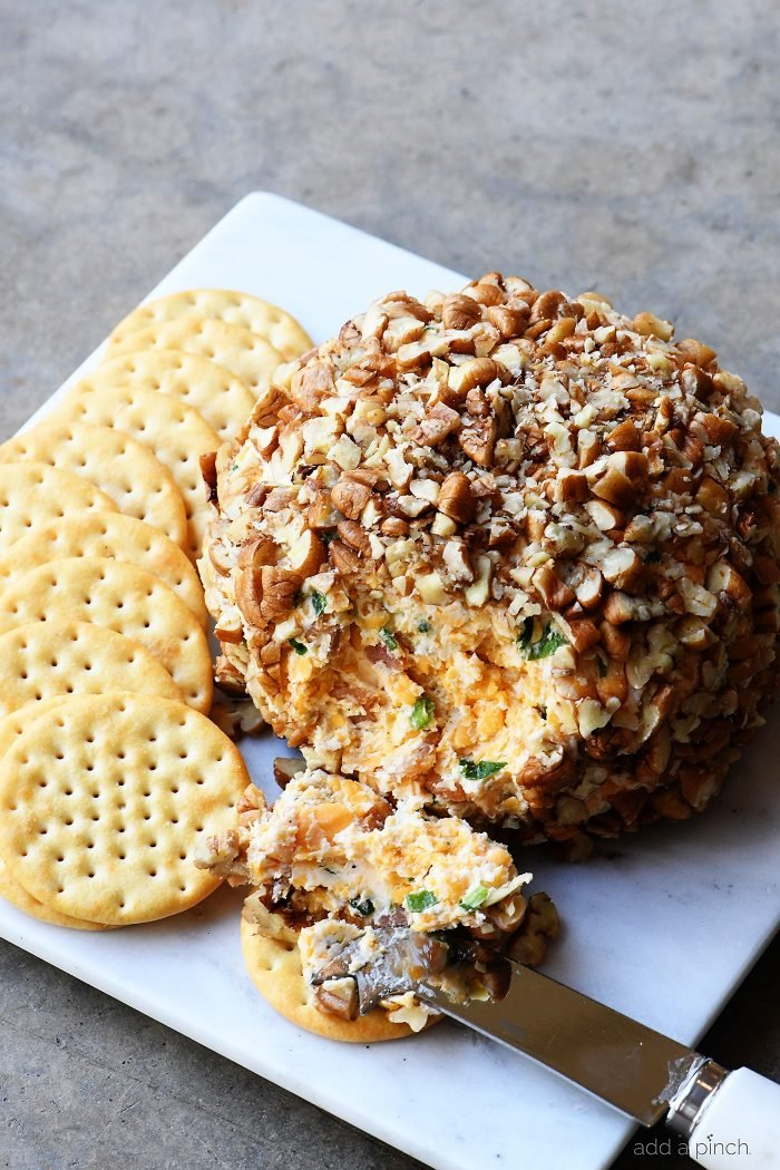 Bacon Ranch Cheese Ball Recipe - This creamy, dreamy cheese ball melds together bacon, ranch seasoning, and is the encased in chopped pecans. Perfect for easy entertaining! // addapinch.com