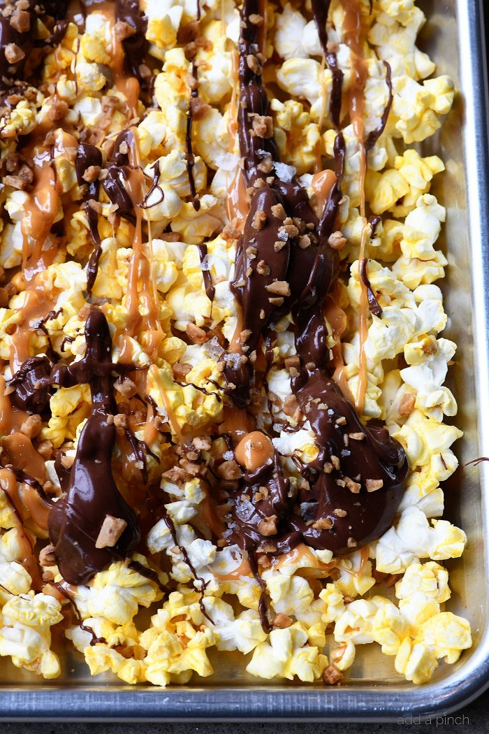 Caramel Crunch Popcorn Recipe - This quick and easy crunch popcorn recipe is perfect for the sweet and salty lover! Ready in minutes! // addapinch.com