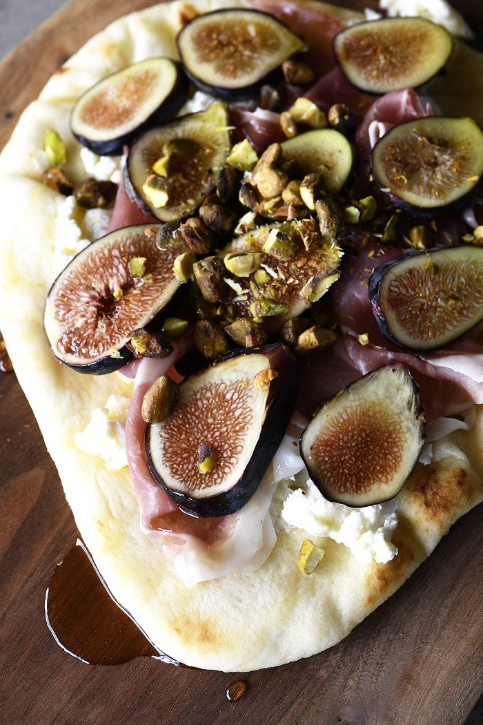 Honeyed Prosciutto Fig Flatbread Recipe - This quick flatbread recipe makes an elegant appetizer recipe that is just as scrumptious as it is beautiful! // addapinch.com