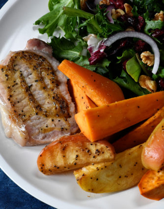 Sheet Pan Pork Chops with Sweet Potatoes and Apples Recipe - This easy one pan meal comes together in a snap! Pork chops, sweet potatoes and apples all basted in a balsamic dijon sauce and baked to perfection! // addapinch.com