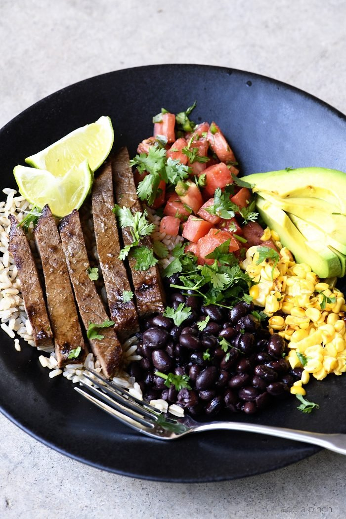 Steak Burrito Bowl Recipe - This easy steak burrito bowl recipe is one that rivals the restaurant version! Ready and on the table in minutes! // addapinch.com