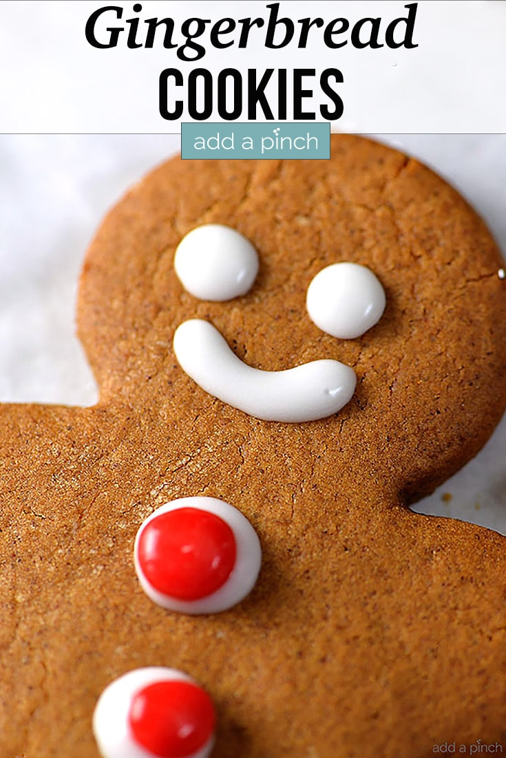 Gingerbread Cookie with eyes, mouth and red candy buttons - with text - addapinch.com