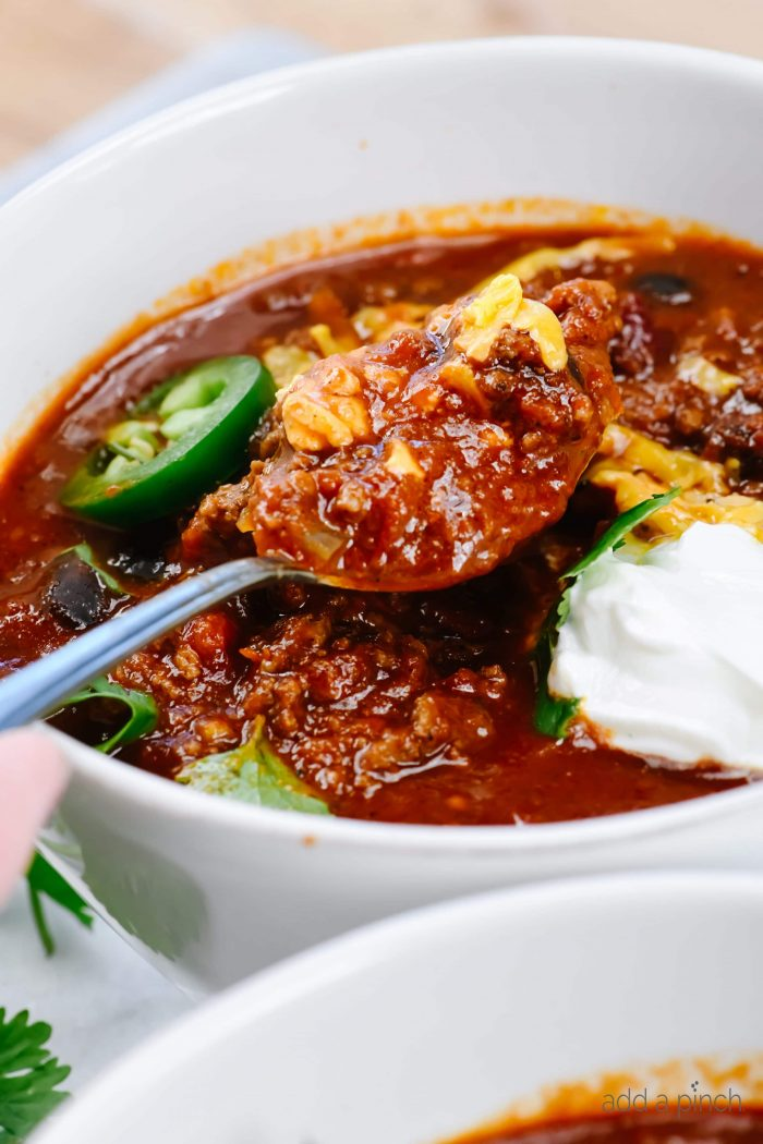 The Best Instant Pot Chili Recipe - This easy Instant Pot Chili is ready in 30 minutes, yet tastes like it has been simmering for hours! // addapinch.com