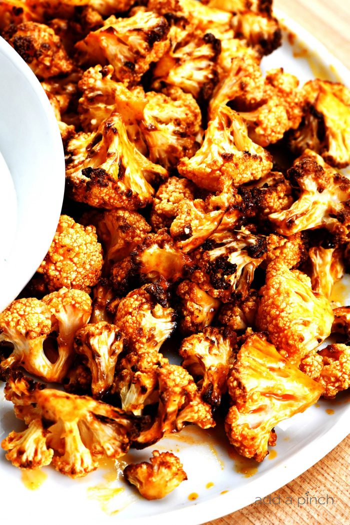 Air Fryer Buffalo Cauliflower Recipe - Liven up your cauliflower with this healthy, delicious buffalo cauliflower recipe made in the air fryer! Ready in minutes and always a hit! // addapinch.com