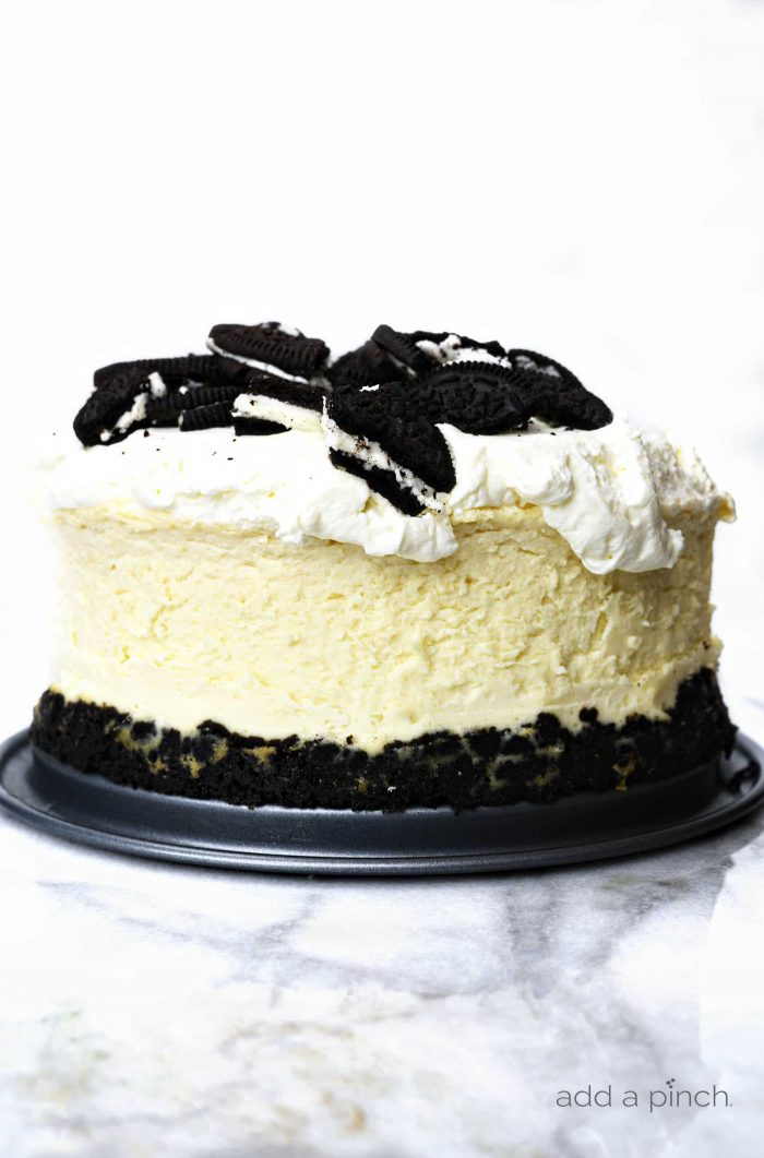 Instant Pot Oreo Cheesecake Recipe - The perfect cheesecake recipe for the Oreo lover! Put your Instant Pot to work to make this delicious, failproof cheesecake recipe in a fraction of the time! // addapinch.com