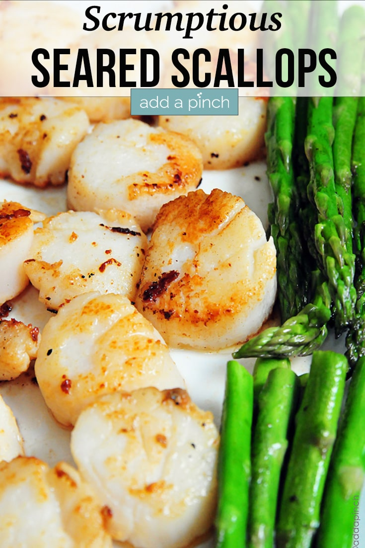 Seared Scallops on tray with steamed asparagus - with text - addapinch.com