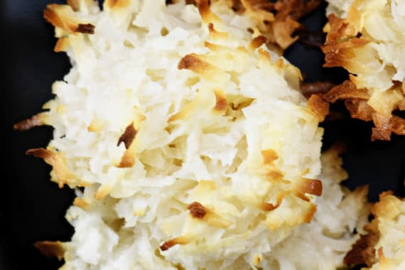 Easy Coconut Macaroons Recipe - These easy coconut macaroons are made with just five ingredients. Golden brown, they are light, chewy and filled with flavorful coconut! // addapinch.com
