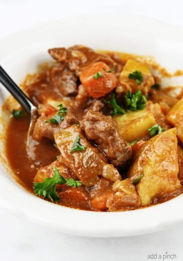 The Best Instant Pot Beef Stew Recipe - Mouthwatering beef stew made with tender chunks of beef, delicious vegetables and a hearty broth makes a favorite Instant Pot recipe!// addapinch.com