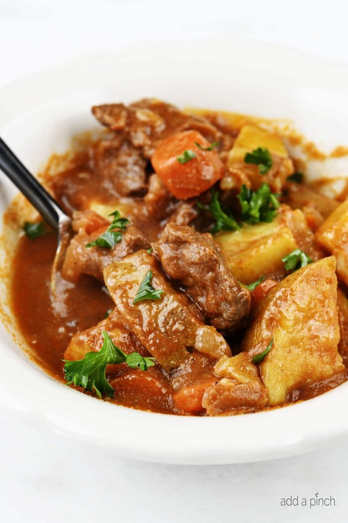 The Best Instant Pot Beef Stew Recipe - Mouthwatering beef stew made with tender chunks of beef, delicious vegetables and a hearty broth makes a favorite Instant Pot recipe! // addapinch.com