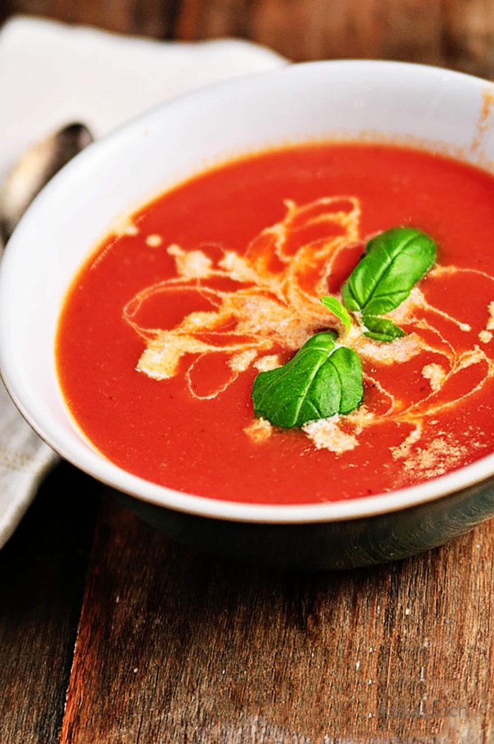 Tomato Soup Recipe - This fresh, homemade tomato soup comes together quickly for a delicious, comforting classic. Ready in 15 minutes!  // addapinch.com