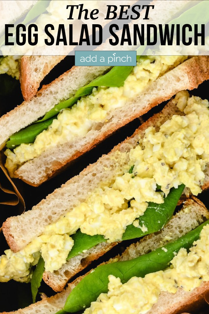 Stack of Egg Salad Sandwiches cut in half - with text - addapinch.com