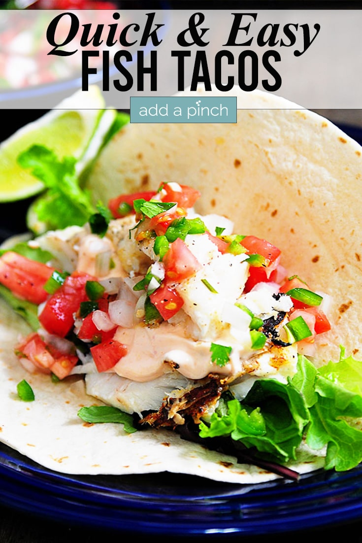 Fish Tacos with lime slice and text - addapinch.com