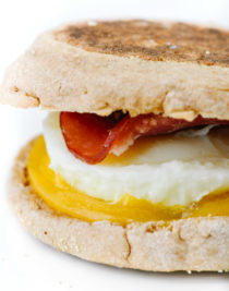 Homemade Egg McMuffin Recipe - Turn the fast-food favorite into an easy homemade recipe everyone will love! Made with buttery English muffins, Canadian bacon, eggs, and cheese! // addapinch.com