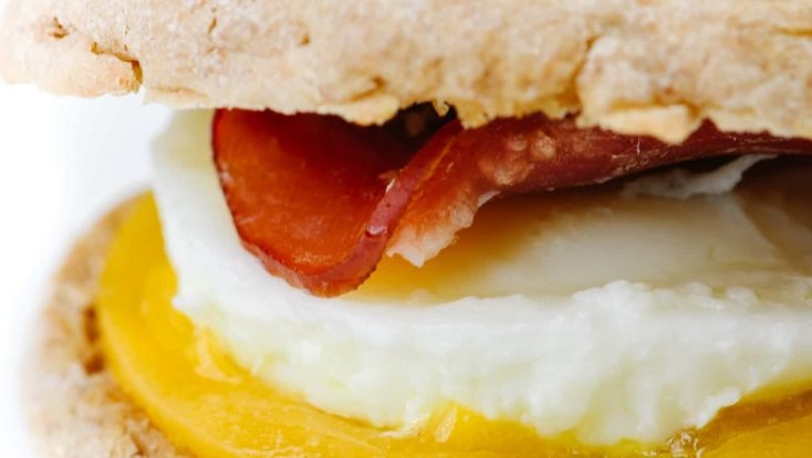 Homemade Egg McMuffin Recipe - Turn the fast-food favorite into an easy homemade recipe everyone will love! Made with buttery English muffins, Canadian bacon, eggs, and cheese!// addapinch.com