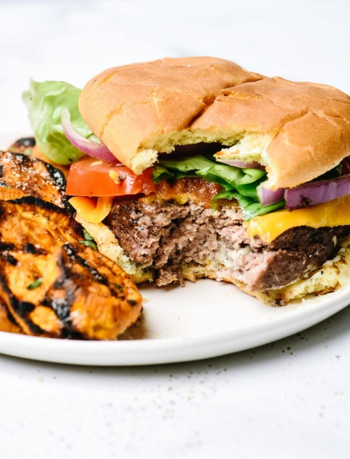 Just 2 ingredients is all you need to take the usual burger recipe the next level for the BEST beef hamburgers I've ever tasted!  // addapinch.com
