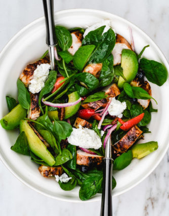 Grilled Chicken Salad with Strawberries and Avocado Recipe - This simple grilled chicken salad is made with fresh spinach, sweet berries and creamy avocado, then tossed with a quick balsamic dressing. Ready in 30 minutes! // addapinch.com