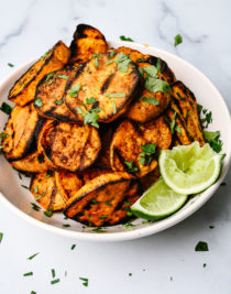 These Spicy Grilled Sweet Potatoes make the perfect side dish! Tender grilled sweet potatoes are coated with a delicious blend of spices for a subtle spicy kick! Ready in minutes! // addapinch.com