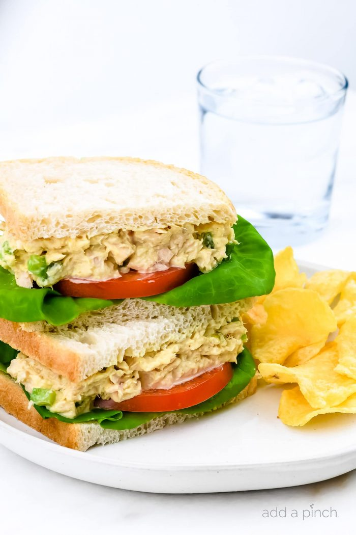 This tuna salad sandwich is so quick and easy and makes for a simple, yet scrumptious meal! Made with tuna, mayonnaise, and a few ingredients that make this the best tuna salad sandwich I've ever tasted! // addapinch.com